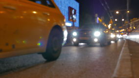 Defocused video. Evening road traffic in the center of Moscow. stock video