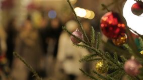 Defocused view of pedestrians walking on beautifully decorated for Christmas. Defocused view of pedestrians walking on beautifully decorated for winter Christmas stock video