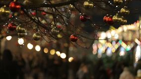 Defocused view of pedestrians walking on beautifully decorated for Christmas. Defocused view of pedestrians walking on beautifully decorated for winter Christmas stock footage