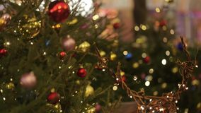 Defocused view of pedestrians walking on beautifully decorated for Christmas. Defocused view of pedestrians walking on beautifully decorated for winter Christmas stock video footage