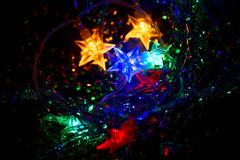 Defocused Xmass Garland with stars. Holiday Stock Image