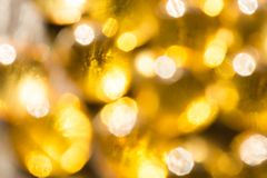 Defocused yellow golden lights. Festive bright background royalty free stock photos