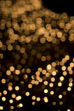 Defocused yellow light dots background Royalty Free Stock Photos