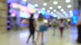 Defocused young women walking in modern shopping mall Stock Images