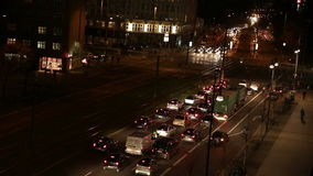 Defocusing cars at night traffic in city Stock Images