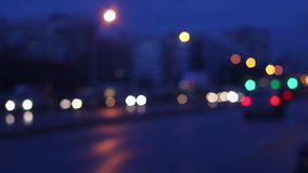 Defocusing shot of urban traffic on a busy road. Cars moving in both directions stock footage