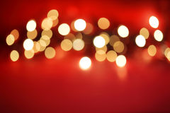Defocussed lights on red Stock Photos