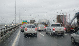 Defocussed traffic viewed through a car windscreen covered Stock Image