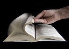 Defoliate a book. Hand defoliate a book royalty free stock photos