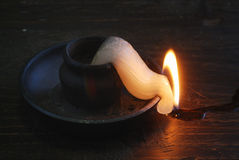 Deformed candle-end Royalty Free Stock Photo