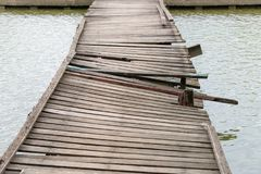 Deformed and dilapidated wooden bridge. Damage old wooden bridge Stock Photos
