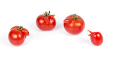 Deformed red tomatoes on a white background Stock Photo