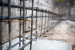 Deformed steel bars frame for beam. Reinforced steel footing or flooring in construction site. image for background, wallpaper, copy space. renovate house Royalty Free Stock Photos