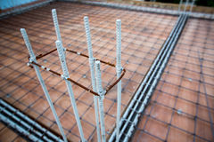 Deformed steel bars frame for beam reinforced steel footing or flooring in construction site. Stock Images