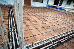 Deformed steel bars frame for beam reinforced steel footing or flooring in construction site. Stock Image