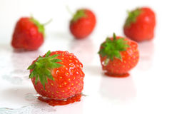 Defrosted strawberries. On a white surface Royalty Free Stock Image