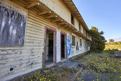 Defunct and abandoned housing in Monterey County, California. Long shot of dilapidated structure with glimpse of destroyed interior royalty free stock images