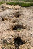 Degenerecy van grondgrond een gat van D stock foto