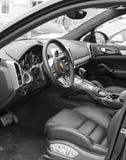 Deggendorf, Germany - 23. APRIL 2016: interior of a 2016 Porsche Cayenne Turbo SUV during the luxury cars presentation in Deggendo. Exclusive black interior of a Stock Image