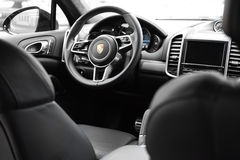 Deggendorf, Germany - 23. APRIL 2016: interior of a 2016 Porsche Cayenne Turbo SUV during the luxury cars presentation in Deggendo. Exclusive black interior of a Royalty Free Stock Image