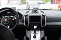 Deggendorf, Germany - 23. APRIL 2016: interior of a 2016 Porsche Cayenne Turbo SUV during the luxury cars presentation in Deggendo. Exclusive black interior of a Stock Photography