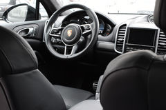 Deggendorf, Germany - 23. APRIL 2016: interior of a 2016 Porsche Cayenne Turbo SUV during the luxury cars presentation in Deggendo. Exclusive black interior of a Stock Images