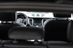 Deggendorf, Germany - 23. APRIL 2016: interior of a 2016 Porsche Macan Turbo SUV during the luxury cars presentation in Deggendorf. Interior of a brand new 2016 Royalty Free Stock Images