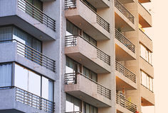 Degrade building. Balconies of a building are lit with fading sunlight Royalty Free Stock Photography