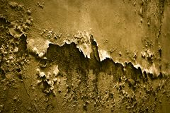 Degraded plaster in golden color - Toned image Stock Photography