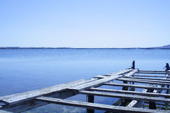 Dilapidated jetty. Or quay with only a few wooden planks remaining, beside the Mediterranean Sea stock images