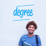 Degree against happy student holding book Stock Images