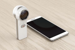 360 degree camera and smartphone. On wood background Stock Image