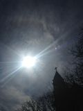 22 Degree Halo around Sun in front of Church. Royalty Free Stock Photo