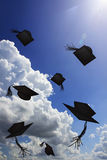 Degree hat throw in sunshine and blue sky Stock Photo