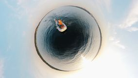 360-degree reverse panorama of two men drifting in the dinghy