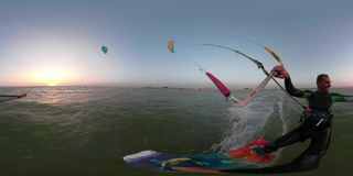 360 degrees, the man in a suit for diving deals in kitesurfing on the sea. A happy mum is engaged in kitesurfing on the sea, 360 degrees stock video footage