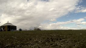 180 degrees time lapse from Nomads landscape with yurt (ger) stock video footage