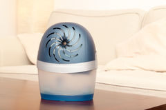 Dehumidifier in living room. Abient light Royalty Free Stock Photography