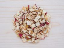 Dehydrated apple flakes in wooden plate Royalty Free Stock Images