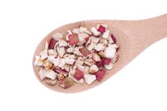 Dehydrated apple flakes in wooden spoon Stock Photography