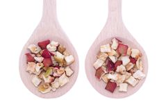 Dehydrated apple flakes in wooden spoons Stock Photo