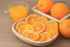 Dehydrated dried and fresh orange with juice Royalty Free Stock Photos