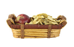 Dehydrated and fresh apples in a basket Stock Images