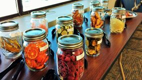 Dehydrated fruits and vegetables in labeled mason jars
