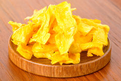 Dehydrated mango on wooden platter Royalty Free Stock Images