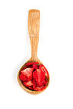 Dehydrated sliced strawberries in a wooden spoon Stock Photos