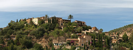 Deia city , Mallorca , Spain. Small coastal historic village of Deia in Tramuntana mountains ( Mallorca , Spain Stock Photos