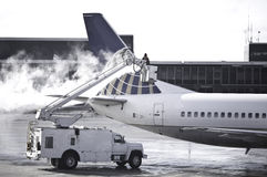 Deicing. Passenger plane getting de iced at the airport Stock Image