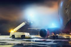 Deicing of the airplane. Airport in winter. Deicing of the airplane before flight Royalty Free Stock Image