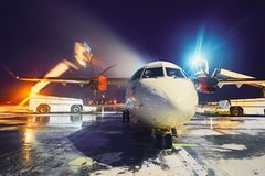 Deicing of the airplane. Airport in winter. Deicing of the airplane before flight Royalty Free Stock Images